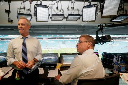 Joe Buck, Troy Aikman. Fox Sports play-by-play announcer Joe Buck, left, and analyst Troy Aikman, right, work in the broadcast booth before a preseason NFL football game between the Miami Dolphins and Jacksonville Jaguars in Miami Gardens, Fla. Chris Myers and Erin Andrews will be doing a little bit of everything on the sidelines for Fox's broadcast of Super Bowl 54. Not only will they be filing reports, but will be the eyes and ears for the production truck as well as Joe Buck and Troy Aikman in the booth