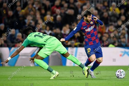 Lionel Messi of FC Barcelona and Chidozie Collins Awaziem of CD Leganes