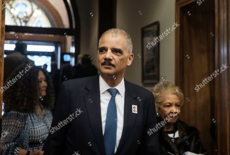 Former Attorney General Eric Holder arrives for a ceremony to unveil the new Gwen Ifill Black Heritage Commemorative Forever Stamp during a Postal Service ceremony at the Metropolitan African Methodist Episcopal Church, in Washington
