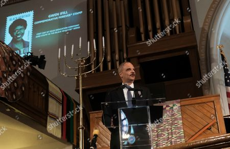 Stock Photo of Former Attorney General Eric Holder delivers remarks at a ceremony to unveil the new Gwen Ifill Black Heritage Commemorative Forever Stamp at the Metropolitan African Methodist Episcopal Church, in Washington