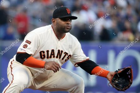 San Francisco Giants third baseman Pablo Sandoval get set during a baseball game against the Chicago Cubs in San Francisco. The 33-year-old Sandoval is working back from season-ending Tommy John reconstructive surgery on his right elbow