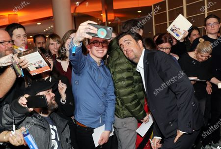 Bastian Pastewka (C-R) poses with fans on the red carpet for the premiere of the tenth season of 'Pastewka', in Berlin, Germany, 30 January 2020. Pastewka is a German television sitcom that ran initially from 2005 to 2014. German actor Bastian Pastewka stars as a fictionalized version of himself.