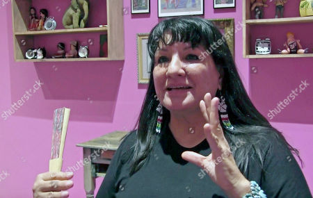 """In this July 27, 2016 photo, acclaimed Mexican American author Sandra Cisneros talks about a new art exhibit based by her 1984 novel """"The House On Mango Street"""" at the National Hispanic Cultural Center in Albuquerque, N.M. Cisneros told the Latino USA radio host Maria Hinojosa, that she appreciated the work by Jeanine Cummins and didn't understand the criticism her novel, """"American Dirt"""" is facing about Mexican stereotypes"""