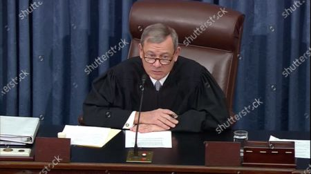 In this image from United States Senate television, Chief Justice of the US John G Roberts Jnr, Jr. presides during the second day of questions at the impeachment trial of US President Trump in the US Senate in the US Capitol