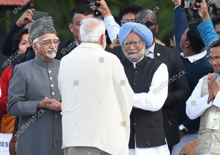 Prime Minister Narendra Modi greets former Prime Minister Manmohan Singh and former Vice President Mohammad Hamid Ansari after paying homage to Mahatma Gandhi on his 72nd death anniversary, at Gandhi Smriti.