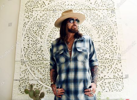 "Billy Ray Cyrus poses for a portrait at his home in Los Angeles on. The Kentucky-born singer won his first Grammy this year for his collaboration with rapper Lil Nas X on ""Old Town Road."" He's releasing a three-song EP on Friday, ""The Singing Hills Sessions: Vol. 1"