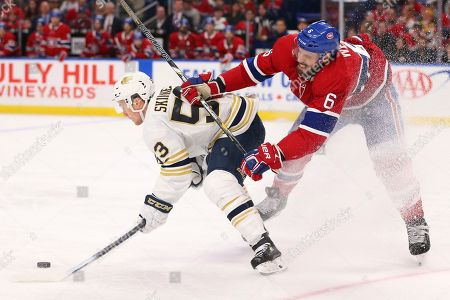 Buffalo Sabres forward Jeff Skinner (53) is checked by Montreal Canadiens defenseman Shea Weber (6) during the third period of an NHL hockey game, in Buffalo, N.Y