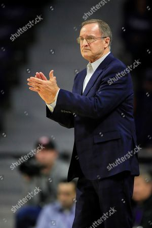 Stock Image of Oklahoma head coach Lon Kruger directs his team during the first half of an NCAA college basketball game against Kansas State in Manhattan, Kan