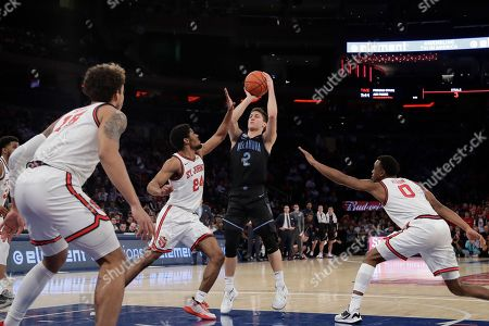 Stock Image of Villanova's Collin Gillespie (2) shoots over St. John's Nick Rutherford (24) during the first half of an NCAA college basketball game, in New York