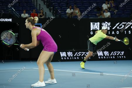 Henri Kontinen of Finland and Gabriela Dabrowski of Canada in action during their mixed doubles semifinal match against Barbora Krejcikova of Czech Republic and Nikola Mektic of Croatia at the Australian Open Grand Slam tennis tournament in Melbourne, Australia, 31 January 2020.