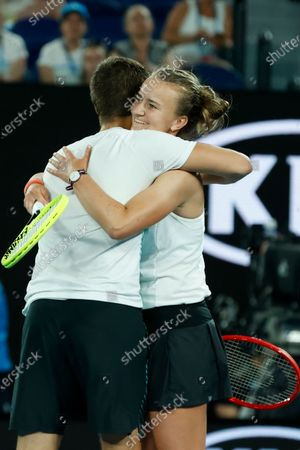 Stock Photo of Barbora Krejcikova of Czech Republic and Nikola Mektic of Croatia reacts after winning their mixed doubles semifinal match against Henri Kontinen of Finland and Gabriela Dabrowski of Canada at the Australian Open Grand Slam tennis tournament in Melbourne, Australia, 31 January 2020.