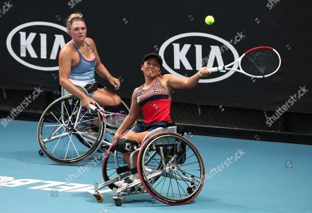 Japan's Yui Kamiji, right, hits a forehand return as her partner Britain's Jordanne Whiley watches against Dieke De Groot and Aniek Van Koot of the Netherlands in the women's wheelchair doubles final at the Australian Open tennis championship in Melbourne, Australia