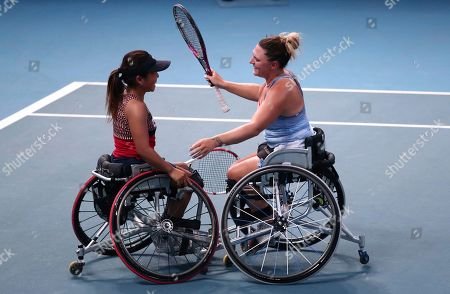 Japan's Yui Kamiji, left, and Britain's Jordanne Whiley celebrate after defeating Dieke De Groot and Aniek Van Koot of the Netherlands in the women's wheelchair doubles final at the Australian Open tennis championship in Melbourne, Australia