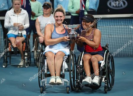 Japan's Yui Kamiji, right, and Britain's Jordanne Whiley pose with their trophy after defeating Dieke De Groot and Aniek Van Koot of the Netherlands in the women's wheelchair doubles final at the Australian Open tennis championship in Melbourne, Australia