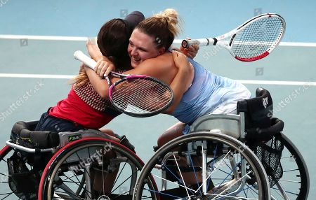 Japan's Yui Kamiji, left, and Britain's Jordanne Whiley, right, celebrate after defeating Dieke De Groot and Aniek Van Koot of the Netherlands in the women's wheelchair doubles final at the Australian Open tennis championship in Melbourne, Australia