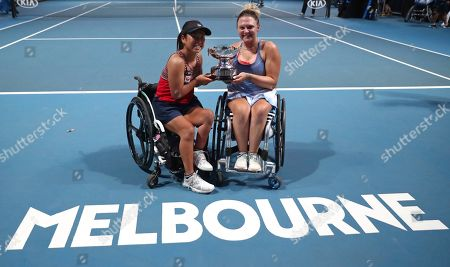Japan's Yui Kamiji, left, and Britain's Jordanne Whiley pose with their trophy after defeating Dieke De Groot and Aniek Van Koot of the Netherlands in the women's wheelchair doubles final at the Australian Open tennis championship in Melbourne, Australia