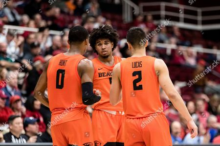 Oregon State guard Ethan Thompson, center, talks with Gianni Hunt (0) andJarod Lucas (2) during the second half of an NCAA college basketball game against Stanford, in Stanford, Calif. Oregon State won 68-63