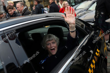 British MEP Ann Widdecombe gestures as she leaves with other party members the European Parliament in Brussels to take the Eurostar train back to Britain, . The U.K. is due to leave the EU on Friday the first nation in the bloc to do so