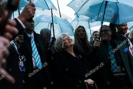 British MEP Ann Widdecombe, center, smiles as she leaves with other party members the European Parliament in Brussels to take the Eurostar train back to Britain, . The U.K. is due to leave the EU on Friday the first nation in the bloc to do so