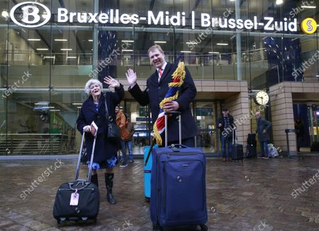 British members of the European Parliament (MEPs) Ann Widdecombe (L) and Jonathan Bullock wave outside the Brussels Midi railway station after leaving the EU Parliament for the last time, in Brussels, Belgium, 31 January 2020. Britain officially exits the EU on 31 January 2020, beginning an eleven month transition period.
