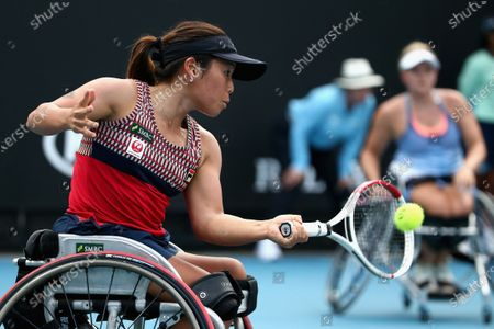 Yui Kamiji of Japan plays a forehand during her wheelchair doubles final with Jordanne Whiley of Great Britain against Diede De Groot of the Netherlands and Anieke Van Koot of the Netherlands during day 12 of the Australian Open tennis tournament in Melbourne, Friday, January 31, 2020.