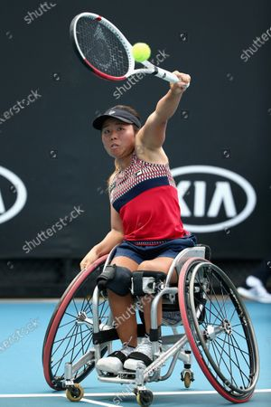 Yui Kamiji of Japan plays a backhand during her wheelchair doubles final with Jordanne Whiley of Great Britain against Diede De Groot of the Netherlands and Anieke Van Koot of the Netherlands during day 12 of the Australian Open tennis tournament in Melbourne, Friday, January 31, 2020.