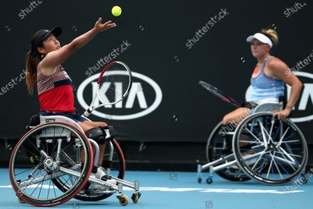 Yui Kamiji of Japan serves during her wheelchair doubles final with Jordanne Whiley (R) of Great Britain against Diede De Groot of the Netherlands and Anieke Van Koot of the Netherlands during day 12 of the Australian Open tennis tournament in Melbourne, Friday, January 31, 2020.