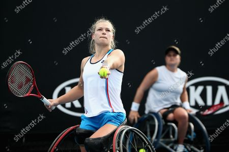 Diede De Groot of the Netherlands serves during her wheelchair doubles final with Anieke Van Koot of the Netherlands against Jordanne Whiley of Great Britain and Yui Kamiji of Japan during day 12 of the Australian Open tennis tournament in Melbourne, Friday, January 31, 2020.
