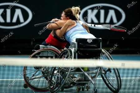 Yui Kamiji (L) of Japan and Jordanne Whiley of Great Britain celebrate after winning their wheelchair doubles final against Diede De Groot of the Netherlands and Anieke Van Koot of the Netherlands at the Australian Open tennis tournament in Melbourne, 31 January 2020.
