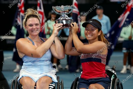 Jordanne Whiley (L) of Great Britain and Yui Kamiji of Japan pose for photographs after winning their wheelchair doubles final against Diede De Groot of the Netherlands and Anieke Van Koot of the Netherlands at the Australian Open tennis tournament in Melbourne, 31 January 2020.