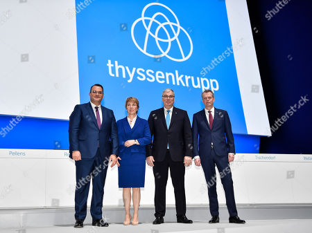 Stock Image of Board members Oliver Burkhard, CEO Martina Merz, Johannes Dietsch and Klaus Keysberg, from left, pose in front of a logo during the annual shareholders meeting of the German industrial conglomerate ThyssenKrupp AG in Bochum, Germany, . After a failed steel joint venture with Tata steel last year, struggling ThyssenKrupp wants to sell its elevator business