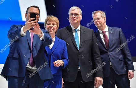 Stock Picture of Board members Oliver Burkhard, CEO Martina Merz, Johannes Dietsch and Klaus Keysberg, from left, take a selfie during the annual shareholders meeting of the German industrial conglomerate ThyssenKrupp AG in Bochum, Germany, . After a failed steel joint venture with Tata steel last year, struggling ThyssenKrupp wants to sell its elevator business