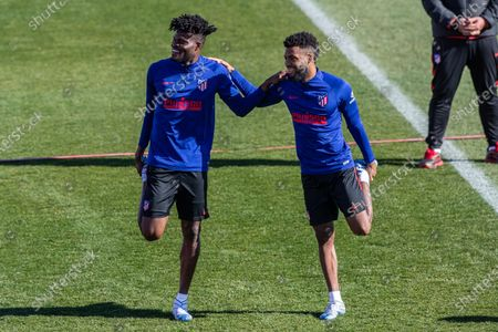 Atletico de Madrid's Thomas Partey (L) and  Thomas Lemar (R) attend the team's training session at Wanda sports city in Majadahonda, Madrid, Spain, 31 January 2020. Atletico de Madrid will be facing Real Madrid in a Spanish Primera Division LaLiga soccer match on 01 February 2020.