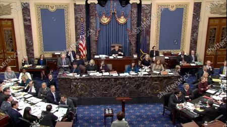 In this image from United States Senate television, Chief Justice of the US John G Roberts Jnr, Jr. awaits a written question from a Senator