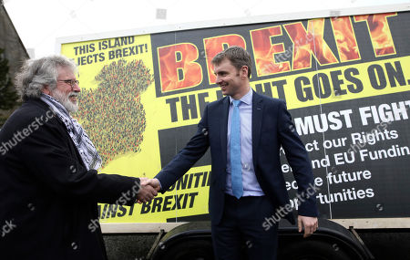 Stock Picture of Former Sinn Fein leader Gerry Adams, left, greets party member Ruairi O'Murchu in front of a placard rejecting Brexit, in Carrickarnon, Ireland, . Britain officially leaves the European Union on Friday after a debilitating political period that has bitterly divided the nation since the 2016 Brexit referendum