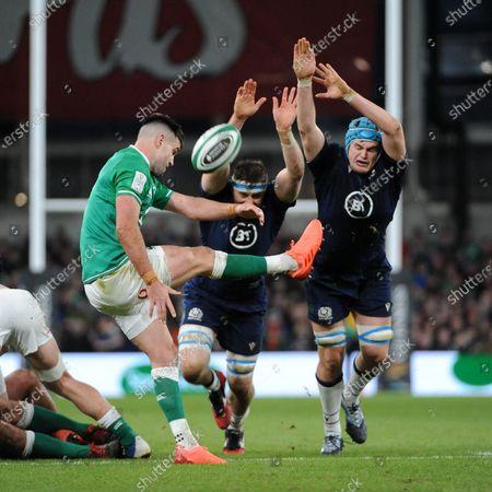 Conor Murray - Ireland scrum half gets his kick away under pressure from Nick Haining and Scott Cummings.