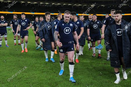 Stock Photo of (l to R) The pain of defeat is etched on the faces of Scotland players as they leave the field at the end of the match. - Cornell du Preez, Ben Toolis, Blair Kinghorn, Alan Dell, Rory Sutherland, Huw Jones, Chris Harris, Stuart Hogg-captain, Adam Hastings, Fraser Brown, Nick Haining, Zander Fagerson, Nick Haining, Jonny Gray, Scott Cummings and Ali Price.