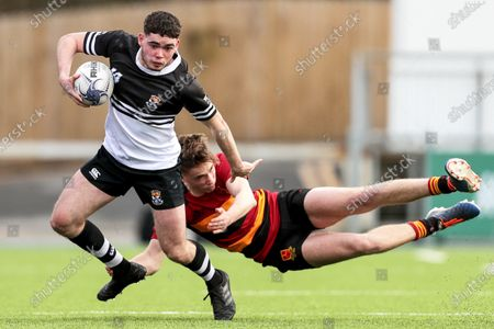 CBC Monkstown vs Newbridge College. Newbridge College's James Gaire is tackled by James Newman of CBC Monkstown