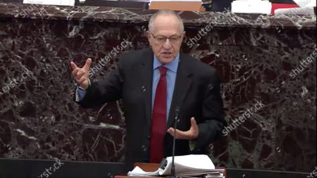 Stock Photo of In this image from United States Senate television, Alan Dershowitz tries to explain his statement from Tuesday evening where he seemed to say if a president sees their own reelection as being in the national interest he cannot be considered corrupt unless it also involves a crime, during question-and-answer portion of the impeachment trial of US President Donald J. Trump in the US Senate in the US Capitol