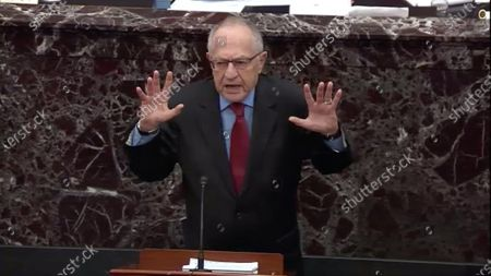 In this image from United States Senate television, Alan Dershowitz tries to explain his statement from Tuesday evening where he seemed to say if a president sees their own reelection as being in the national interest he cannot be considered corrupt unless it also involves a crime, during question-and-answer portion of the impeachment trial of US President Donald J. Trump in the US Senate in the US Capitol