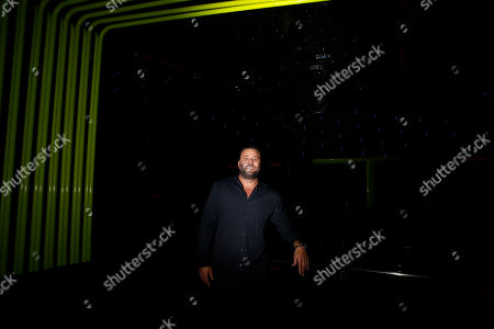 """David Grutman poses for a portrait at LIV night club, in Miami Beach, Fla. Grutman is preparing for Super Bowl 2020, """"Miami on its own is always over the top, then you put the Super Bowl on top of it and it's the perfect recipe for decadence and extravagance,"""" says Grutman"""
