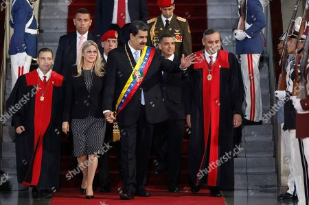 Venezuelan President Nicolas Maduro waves as he arrives with First Lady Cilia Flores to the Supreme Court in Caracas, Venezuela, . Maduro will give an annual presidential address to the court