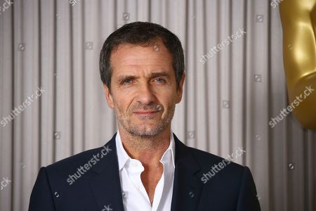David Heyman poses for photographers upon arrival at the Academy Nominees Reception, in central London