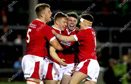 Wales U20 vs Italy U20. Wales' Sam Costelow celebrates scoring the first try of the game with Ben Carter, Osian Knott and Dafydd Buckland