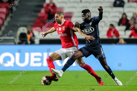 Benfica`s Adel Taarabt (L) fights for the ball with Belenenses SAD's Show during their Portuguese First League soccer match held at Luz Stadium, Lisbon, Portugal, 31th January 2020.