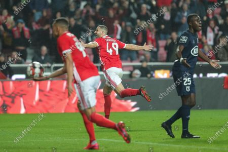 Benfica`s Adel Taarabt (C) celebrates after scoring a goal against Belenenses SAD during their Portuguese First League soccer match held at Luz Stadium, Lisbon, Portugal, 31th January 2020.