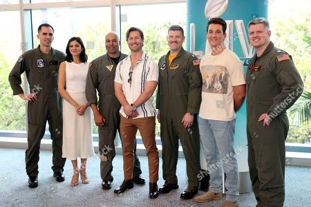 """Glen Powell ; Miles Teller ; Monica Barbaro. Top Gun: Maverick"""" actors, Glen Powell, center, Miles Teller, right and Monica Barbaro take a selfie with the U.S. Navy pilots that will be performing a flyover at the Super Bowl, in Miami Beach, Fla"""