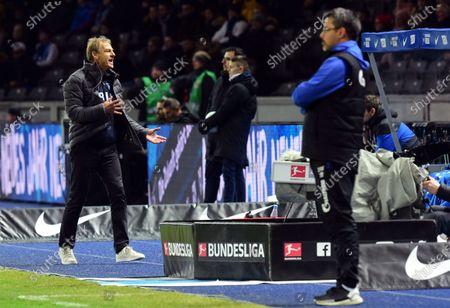 Stock Picture of Hertha's head coach Jurgen Klinsmann (L) reacts next to Schalke's head coach David Wagner (R) during the German Bundesliga soccer match between Hertha BSC and FC Schalke 04 in Berlin, Germany, 31 January 2020.