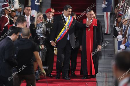 Venezuelan President Nicolas Maduro (C), the head of the Supreme Court of Justice (TSJ) Maikel Moreno (R), and the First Lady Cilia Flores (L) wave during the annual opening ceremony of the TSJ, with which the judicial activities of 2020 begin, in Caracas, Venezuela, 31 January 2020.
