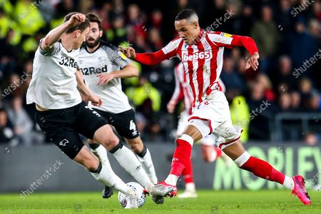 Thomas Ince of Stoke City takes on Craig Forsyth of Derby County